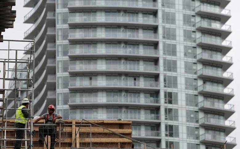 Construction workers chat on a condominium building site in Toronto, Ontario, Canada October 3, 2016. REUTERS/Chris Helgren