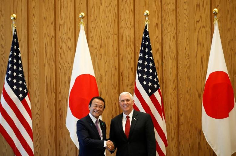 U.S. Vice President Mike Pence (R) is welcomed by Japan's Deputy Prime Minister Taro Aso at the beginning of their talks at the prime minister Shinzo Abe's official residence in Tokyo, Japan April 18, 2017. REUTERS/Kim Kyung-Hoon