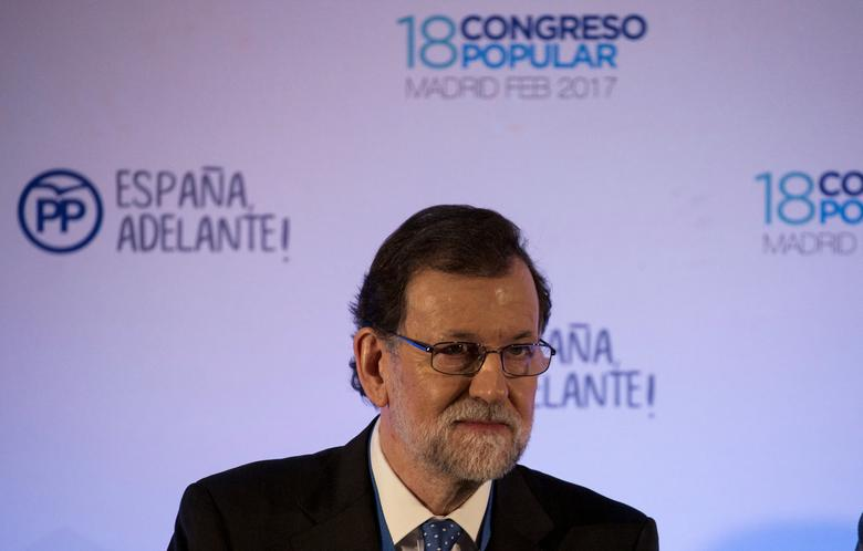 FILE PHOTO: Spanish Prime Minister Mariano Rajoy looks on as he presides over his ruling People's Party (PP) executive committee during party's national convention in Madrid, Spain, February 12, 2017. REUTERS/Sergio Perez/File Photo