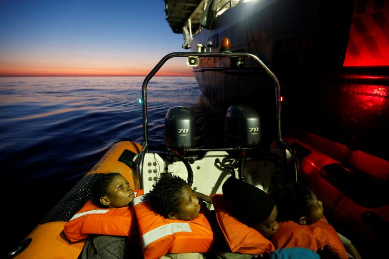 FILE PHOTO: Migrants rescued from a rubber dinghy are brought to the Malta-based NGO Migrant Offshore Aid Station (MOAS) ship Phoenix at dawn in the central Mediterranean in international waters off the coast of Sabratha in Libya. REUTERS/Darrin Zammit Lupi