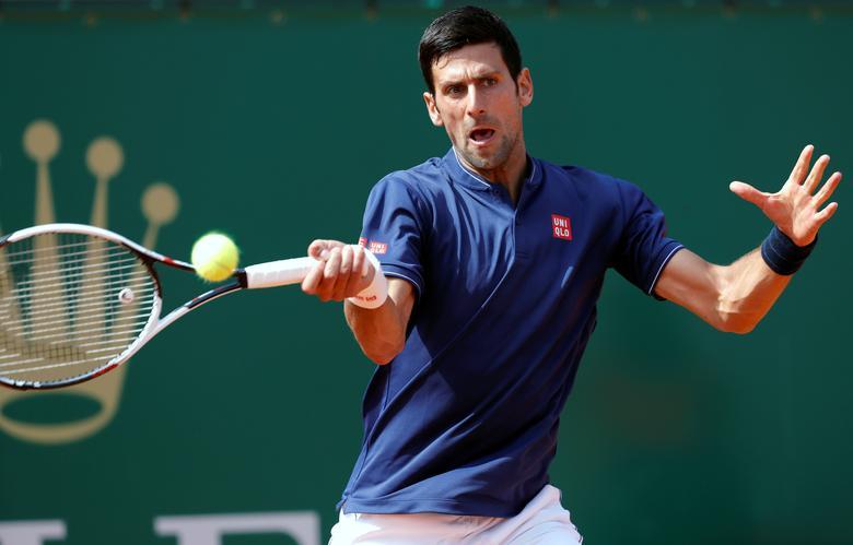 Tennis - Monte Carlo Masters - Monaco, 18/04/2017. Novak Djokovic of Serbia plays a shot to Gilles Simon of France.     REUTERS/Eric Gaillard