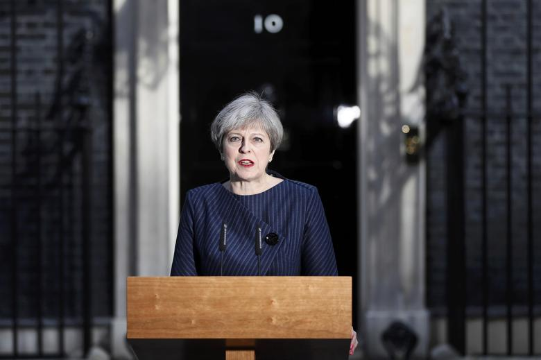 Britain's Prime Minister Theresa May speaks to the media outside 10 Downing Street, in central  London, Britain April 18, 2017.  REUTERS/Stefan Wermuth