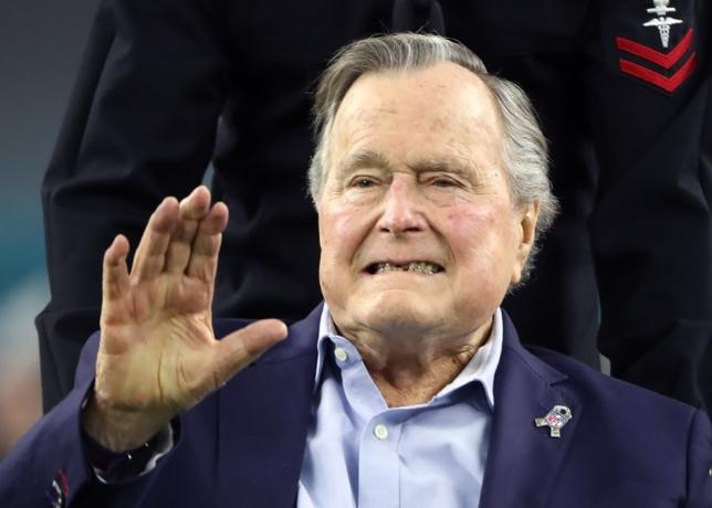 File photo: Former U.S. President George H.W. Bush arrives on the field to do the coin toss ahead of the start of Super Bowl LI between the New England Patriots and the Atlanta Falcons in Houston, Texas, U.S., February 5, 2017. REUTERS/Adrees Latif