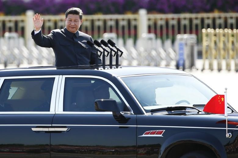 Chinese President Xi Jinping waves as he reviews the army, at the beginning of the military parade marking the 70th anniversary of the end of World War Two, in Beijing, China, September 3, 2015.  REUTERS/Damir Sagolj