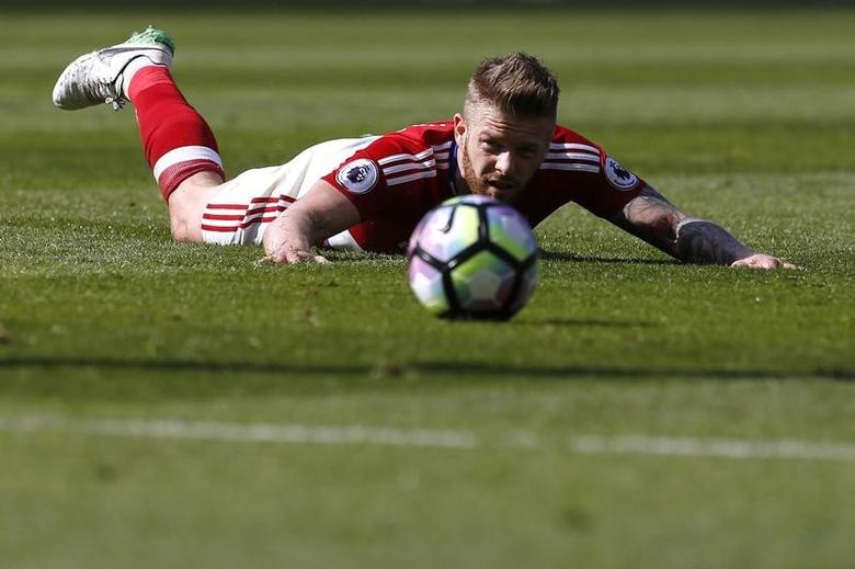 Britain Football Soccer - Middlesbrough v Burnley - Premier League - The Riverside Stadium - 8/4/17 Middlesbrough's Adam Clayton looks at the ball while laying on the pitch Action Images via Reuters / Craig Brough Livepic