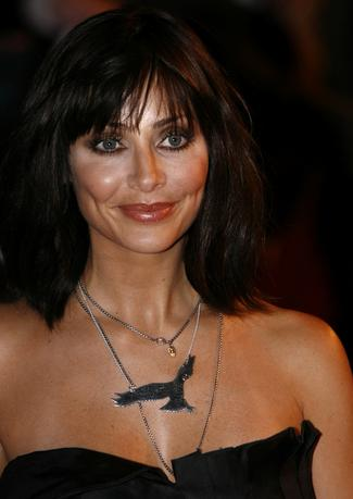 FILE PHOTO: Singer Natalie Imbruglia poses for photographers as she arrives for the Brit Awards at Earls Court in London February 18, 2009. REUTERS/Luke MacGregor/File Photo