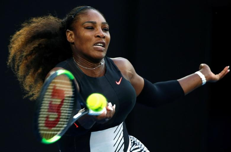 FILE PHOTO: Tennis - Australian Open - Melbourne Park, Melbourne, Australia - 28/1/17 Serena Williams of the U.S. hits a shot during her Women's singles final match against Venus Williams of the U.S. .REUTERS/Thomas Peter/File Photo
