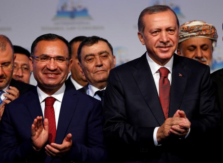 FILE PHOTO: Turkish President Tayyip Erdogan (R) is pictured with Justice Minister Bekir Bozdag during the International Istanbul Law Congress in Istanbul, October 17, 2016. REUTERS/Murad Sezer/Files