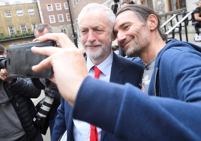 Britain's opposition Labour Party's leader Jeremy Corbyn stops for a selfie as he leaves after giving a speech in central London, April 20, 2017. REUTERS/Toby Melville