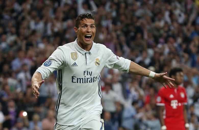 Football Soccer - Real Madrid v Bayern Munich - UEFA Champions League Quarter Final Second Leg - Estadio Santiago Bernabeu, Madrid, Spain - 18/4/17 Real Madrid's Cristiano Ronaldo celebrates scoring their third goal to complete his hat trick  Reuters / Sergio Perez Livepic
