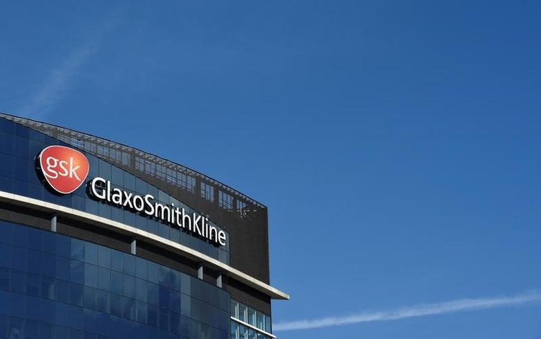 Signage for GlaxoSmithKline is seen on it's offices in London, Britain, March 30, 2016. REUTERS/Toby Melville/File Photo
