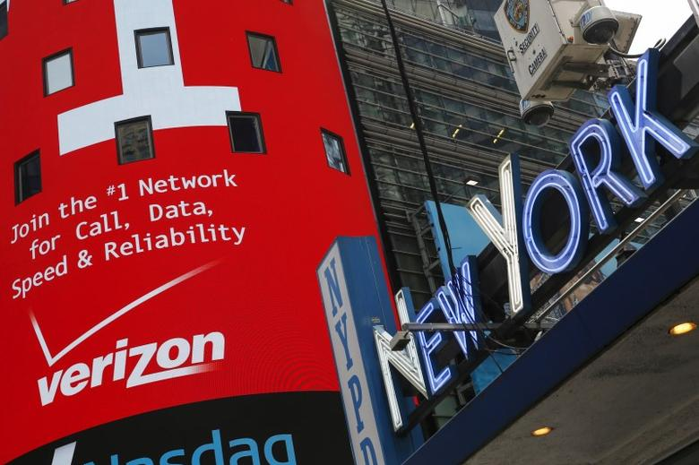 An advertisement for Verizon is seen at Times Square in New York, May 12, 2015. Verizon Communications Inc said on Tuesday it will buy AOL Inc for $4.4 billion, turning the biggest U.S. wireless carrier into a leading provider of content and video for the web and mobile phones.  REUTERS/Shannon Stapleton