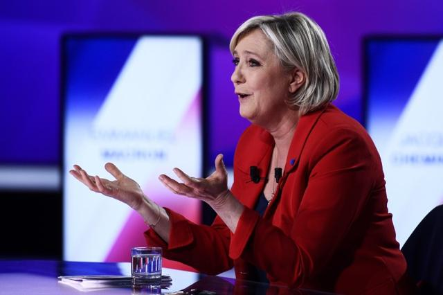 Marine Le Pen, French National Front (FN) political party leader and candidate for French 2017 presidential election, attends the France 2 television special prime time political show, ''15min to Convince'' in Saint-Cloud, near Paris, France, April 20, 2017. REUTERS/Martin Bureau/Pool