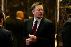 FILE PHOTO: Tesla Chief Executive, Elon Musk enters the lobby of Trump Tower in Manhattan, New York, U.S., January 6, 2017. REUTERS/Shannon Stapleton/File Photo