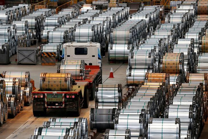 FILE PHOTO: A truck drives past rolls of steel inside the China Steel Corporation factory, in Kaohsiung, southern Taiwan August 26, 2016. REUTERS/Tyrone Siu/File Photo