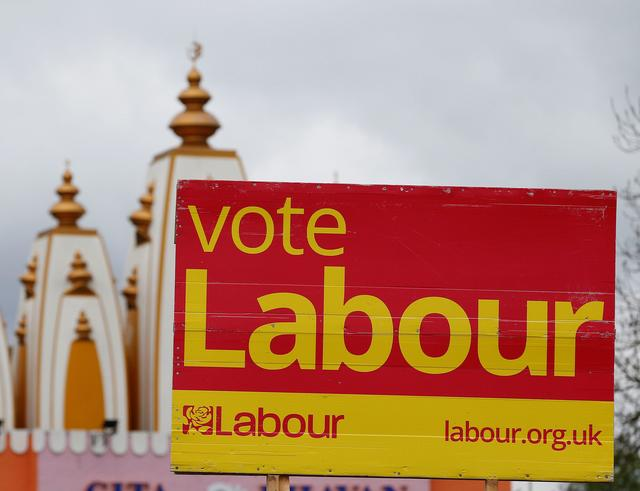 A vote Labour sign is seen near the Gita Bhavan Hindu Temple in Whalley Range, Manchester, Britain April 20, 2017. REUTERS/Andrew Yates