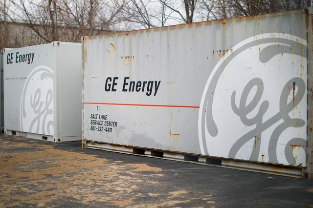 The General Electric (GE) logo marks containers in the parking lot of a facility in Medford, Massachusetts, U.S., April 20, 2017.   REUTERS/Brian Snyder