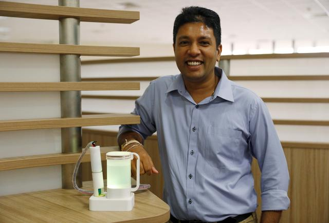 Keio-NUS Researcher Nimesha Ranasinghe poses with his virtual lemonade kit at the National University of Singapore campus in Singapore April 13, 2017. REUTERS/Edgar Su