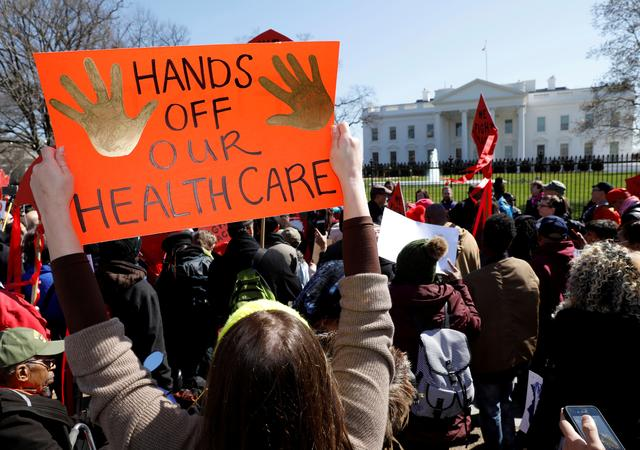 FILE PHOTO: Protesters demonstrate against U.S. President Donald Trump and his plans to end Obamacare outside the White House in Washington, U.S., March 23, 2017. REUTERS/Kevin Lamarque/File Photo