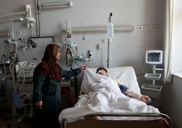 An Afghan national Army (ANA) soldier receives treatment at a hospital a day after a attack on an army headquarters in Mazar-i-Sharif northern Afghanistan April 22, 2017. REUTERS/Anil Usyan