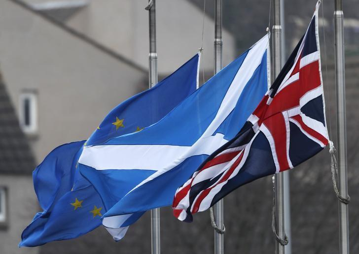 The Union flag, Scotland's Saltire and the European Union flag all fly from Scotland's Parliament building at Holyrood in Edinburgh, December 20, 2016. REUTERS/Russell Cheyne/Files