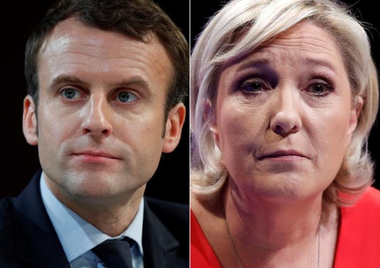 法国总统候选人马克龙和勒庞的拼接图片。二人将在第二轮投票中对决。REUTERS/Christian Hartmann