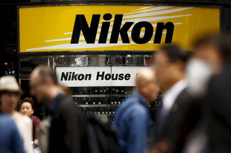 People walk past a retailer of Nikon cameras and lenses in central Tokyo, Japan, April 22, 2016. REUTERS/Thomas Peter