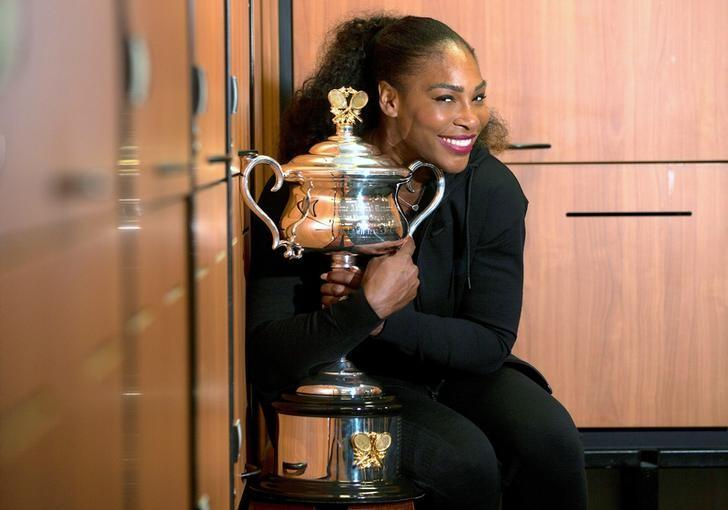 Serena Williams of the U.S. holds the trophy after winning the Women's singles final against sister Venus at the Australian Open tennis tournament in Melbourne, Australia in this handout image taken January 28, 2017.     Fiona Hamilton/Courtesy of Tennis Australia/Handout via REUTERS/File Photo