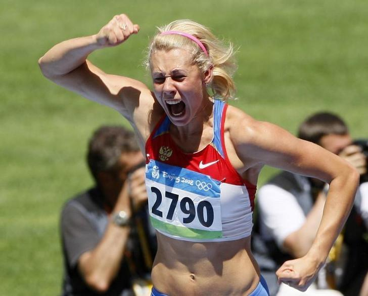 Tatiana Chernova of Russia reacts during her women's heptathlon high jump qualifying round at the National Stadium during the Beijing 2008 Olympic Games August 15, 2008.     REUTERS/Lucy Nicholson/Files
