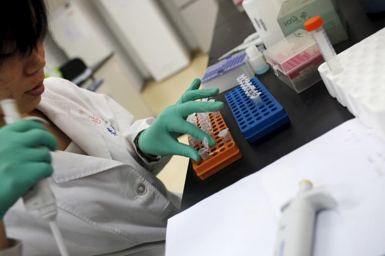 A researcher prepares medicine at a laboratory in Nanjing University in Nanjing, Jiangsu province, China, in this April 29, 2011 file photo. China, already a global powerhouse in high-tech areas from solar panels to bullet trains, is turning its industrial might to the challenge of making more of its own drugs for a vast and ageing population. REUTERS/Aly Song/Files