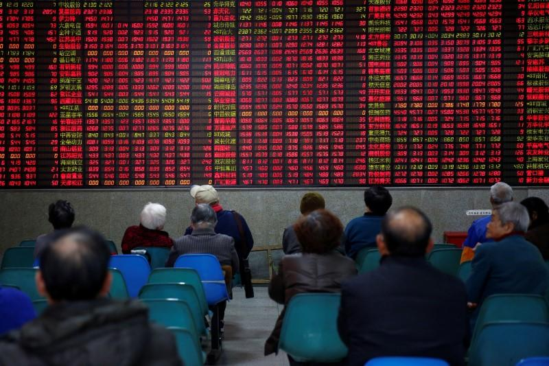 China reviews changes to securities law to fight illegal activity