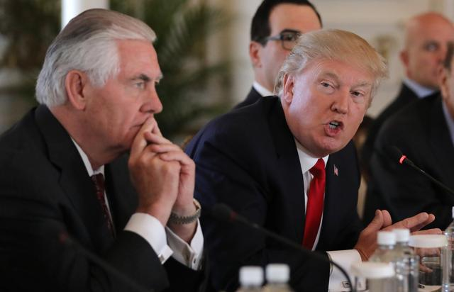 U.S. President Donald Trump (R) speaks next to Secretary of State Rex Tillerson during a bilateral meeting with China's President Xi Jinping (Not Pictured) at Trump's Mar-a-Lago estate in Palm Beach, Florida, U.S., April 7, 2017. REUTERS/Carlos Barria