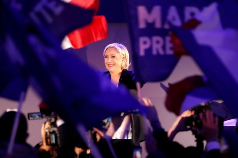 Marine Le Pen, French National Front (FN) political party leader and candidate for French 2017 presidential election, celebrates after early results in the first round of 2017 French presidential election, in Henin-Beaumont, France, April 23, 2017.    REUTERS/Charles Platiau/File Photo
