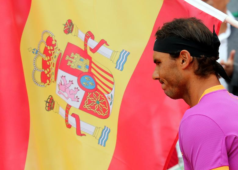 Tennis - Monte Carlo Masters - Monaco - 23/04/2017 - Rafael Nadal of Spain stands near a Spanish flag before his final against his compatriot Albert Ramos-Vinolas at the Monte Carlo Masters. REUTERS/Eric Gaillard