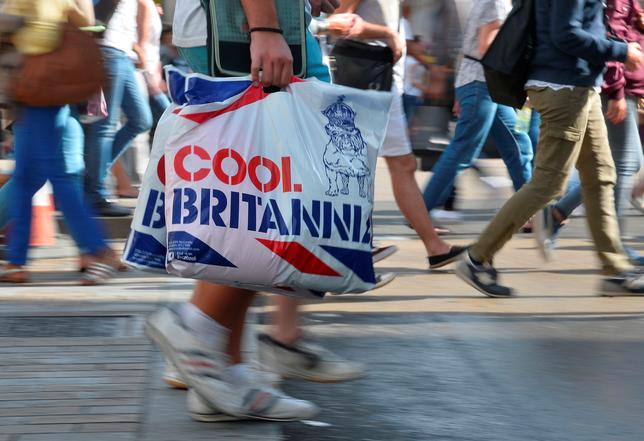 FILE PHOTO - Shoppers cross Oxford Street in central London August 15, 2013. REUTERS/Toby Melville/File Photo