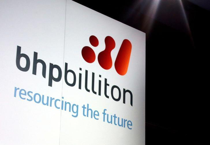 A promotional sign adorns a stage at a BHP Billiton function in Sydney, Australia, August 20, 2013. REUTERS/David Gray/Files
