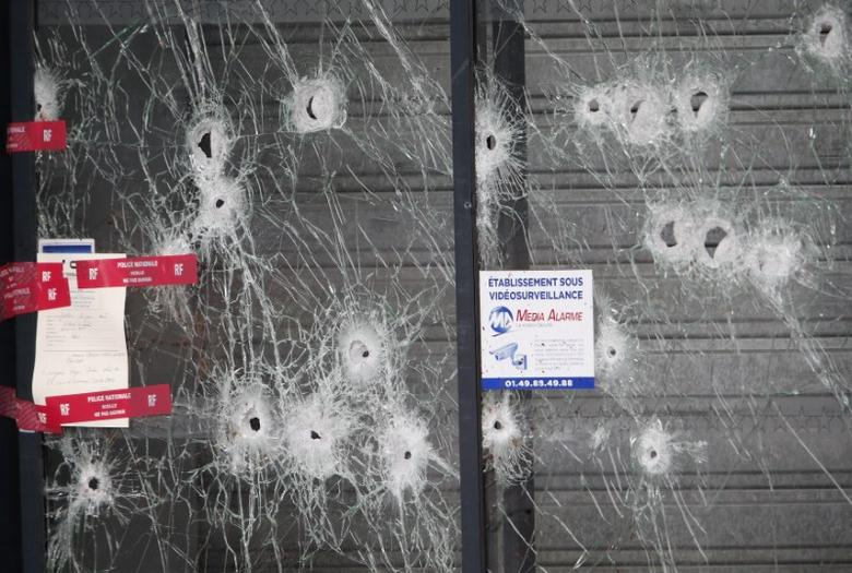 Bullet impacts are seen on the glass store front at the Hyper Cacher kosher supermarket January 12, 2015 near the Porte de Vincennes in Paris, where four hostages were killed. REUTERS/Charles Platiau/Files