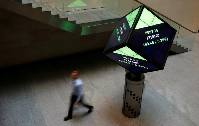 A man walks through the lobby of the London Stock Exchange in London, Britain, August 25, 2015.      REUTERS/Suzanne Plunkett/File Photo/File Photo