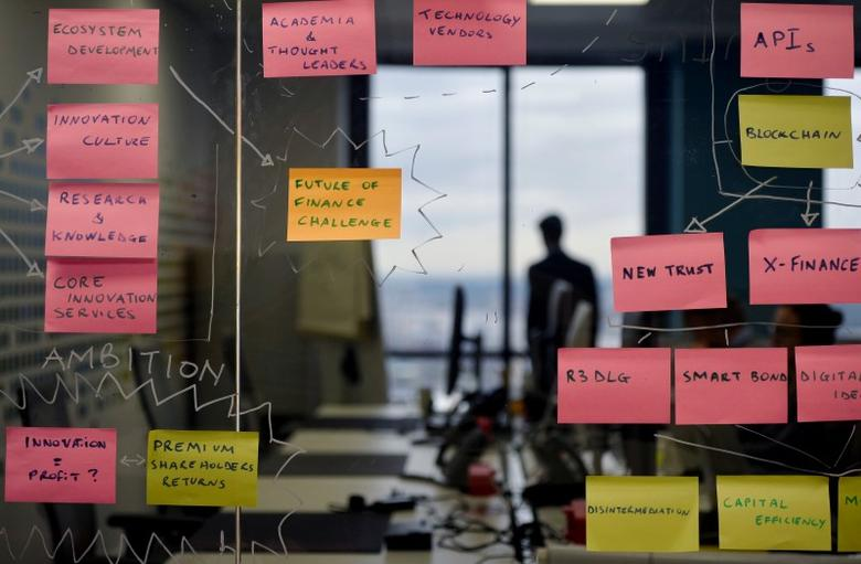 Post-it notes are displayed in the UBS ''fintech lab'' at Canary Wharf in London, Britain, October 19, 2016. REUTERS/Hannah McKay