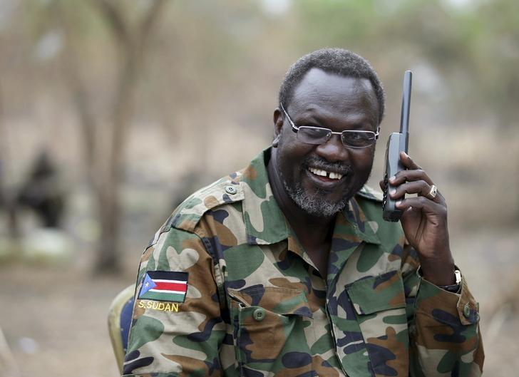 South Sudan's rebel leader Riek Machar talks on the phone in his field office in a rebel-controlled territory in Jonglei State, South Sudan, February 1, 2014. REUTERS/Goran Tomasevic/File Photo
