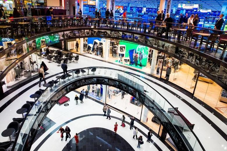 People walk through the Mall of Berlin shopping centre during its opening night in Berlin, September 24, 2014.  REUTERS/Thomas Peter/File Photo