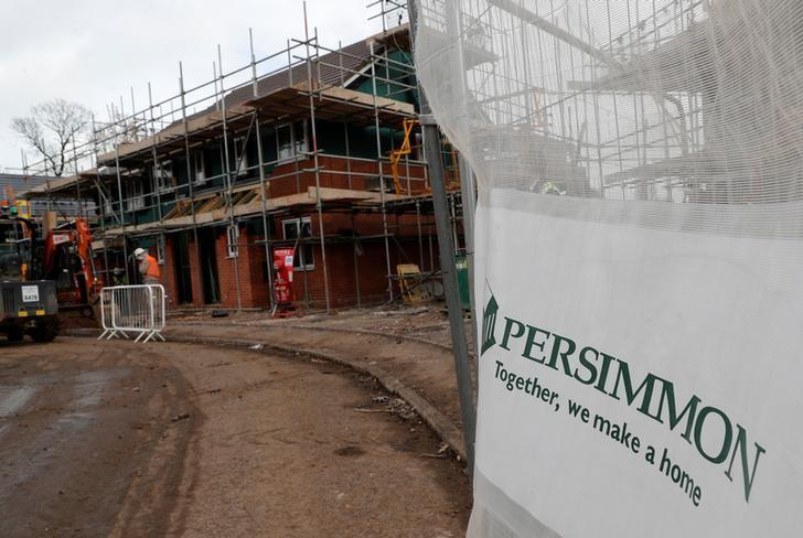 Builders construct modular Space4 homes on a Persimmon development in Coventry, February 22, 2017. REUTERS/Darren Staples