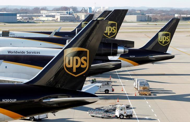 FILE PHOTO: United Parcel Service air craft are being loaded with air containers full of packages bound for their final destination at the UPS Worldport All Points International Hub during the peak delivery month in Louisville, Kentucky, December 3, 2015.      REUTERS/John Sommers II/File Photo