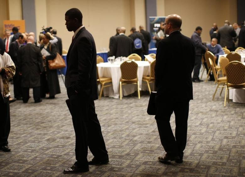 FILE PHOTO: Job seekers stand in a room of prospective employers at a career fair in New York City, October 24, 2012.   REUTERS/Mike Segar