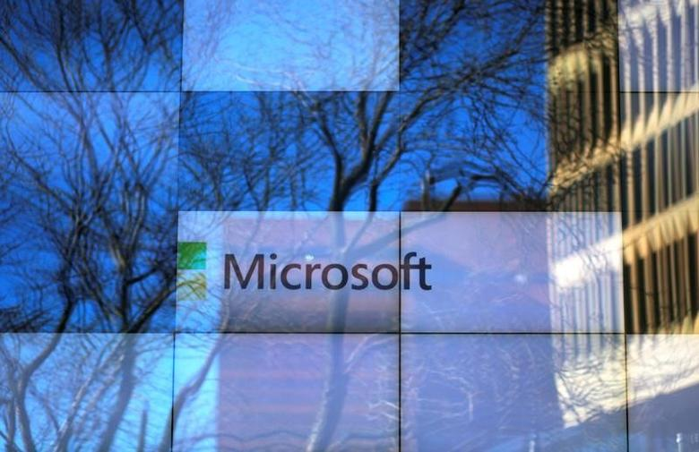 FILE PHOTO: An advertisement is played on a set of large screens at the Microsoft office in Cambridge, Massachusetts, U.S., on January 25, 2017.   REUTERS/Brian Snyder/File Photo