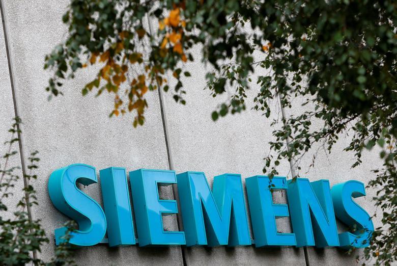 FILE PHOTO: Siemens logo is pictured at Siemens Healthineers headquarters in Erlangen near Nuremberg, Germany, October 7, 2016. REUTERS/Michaela Rehle/File Photo