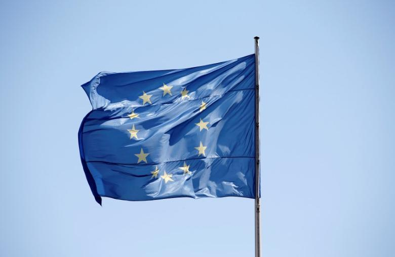 FILE PHOTO: The European Union (EU) flag is seen on a sunny day and blue sky at the Chancellery in Berlin, Germany, April 29, 2016.    REUTERS/Fabrizio Bensch