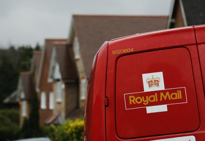 A Royal Mail postal van is parked outside homes in Maybury near Woking in southern England March 25, 2014. REUTERS/Luke MacGregor