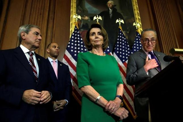 U.S. Senate Minority Leader Chuck Schumer (D-NY) (R) speaks next to House Minority Leader Nancy Pelosi (D-CA) during a news conference on President Trump's first 100 days on Capitol Hill in Washington, U.S April 28, 2017. REUTERS/Yuri Gripas