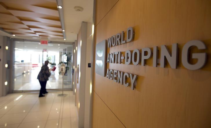 A woman walks into the head office for the World Anti-Doping Agency (WADA) in Montreal, Quebec, Canada on November 9, 2015.  REUTERS/Christinne Muschi/Files